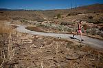 A jogger runs through the abandoned  Northgate Golf Course in Reno, Nevada, May 22, 2012.