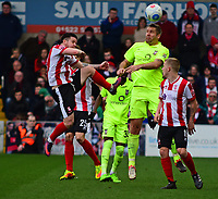 York City's Jon Parkin wins a header under pressure from Lincoln City's Billy Knott<br /> <br /> Photographer Andrew Vaughan/CameraSport<br /> <br /> Buildbase FA Trophy Semi Final Second Leg - Lincoln City v York City - Saturday 18th March 2017 - Sincil Bank - Lincoln<br />  <br /> World Copyright &copy; 2017 CameraSport. All rights reserved. 43 Linden Ave. Countesthorpe. Leicester. England. LE8 5PG - Tel: +44 (0) 116 277 4147 - admin@camerasport.com - www.camerasport.com