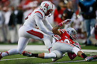 Ohio State Buckeyes wide receiver Devin Smith (9) is tackled in the third quarter of an NCAA college football game between The Ohio State Buckeyes and the Rutgers Scarlet Knights at Ohio Stadium on Saturday, October 18, 2014.  (Columbus Dispatch photo by Fred Squillante)