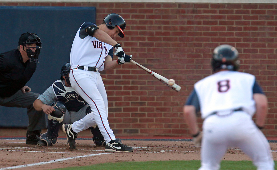Virginia Matt Thaiss (21) drives in runs during the second inning against George Washington during the game Wednesday at Davenport Stadium in Charlottesville, VA. Photo/The Daily Progress/Andrew Shurtleff
