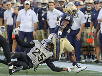 Annapolis, MD - October 21, 2017: Navy Midshipmen running back Darryl Bonner (29) breaks a tackle during the game between UCF and Navy at  Navy-Marine Corps Memorial Stadium in Annapolis, MD.   (Photo by Elliott Brown/Media Images International)