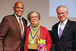 Harry Belafonte, Marian Wright Edelman, and Jeremy Travis pose on stage, at the John Jay Justice Award ceremony, April 5 2011.