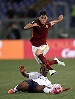 Calcio, Serie A: Roma vs Bologna. Roma, stadio Olimpico, 11 aprile 2016.<br /> Roma's Iago Falque, top,is tackled by Bologna's Godfred Donsah during the Italian Serie A football match between Roma and Bologna at Rome's Olympic stadium, 11 April 2016.<br /> UPDATE IMAGES PRESS/Isabella Bonotto