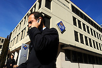 Businessman using a mobile phone outside the headquarters of LGT, the largest bank in the country, owned by the ruling royal family. Liechtenstein has become a major tax haven, whose opaque banking laws are said to aid fraud, money laundering and tax evasion. There are an estimated 75,000 companies registered in the country, twice that of the population. .