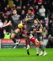 Lincoln City's Jason Shackell, left, and Bruno Andrade clear under pressure from Stevenage's Alex Revell<br /> <br /> Photographer Andrew Vaughan/CameraSport<br /> <br /> The EFL Sky Bet League Two - Stevenage v Lincoln City - Saturday 8th December 2018 - The Lamex Stadium - Stevenage<br /> <br /> World Copyright © 2018 CameraSport. All rights reserved. 43 Linden Ave. Countesthorpe. Leicester. England. LE8 5PG - Tel: +44 (0) 116 277 4147 - admin@camerasport.com - www.camerasport.com