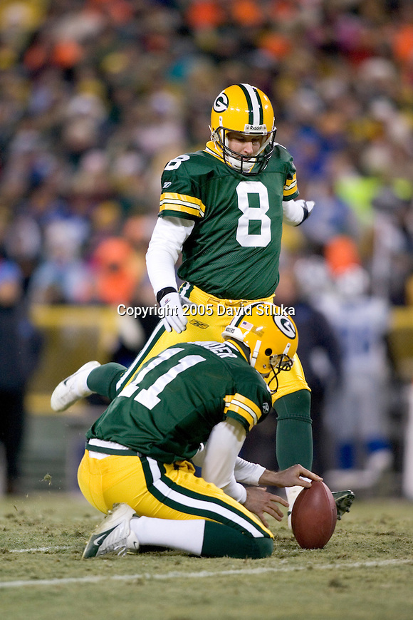 Kicker Ryan Longwell #8 of the Green Bay Packers kicks a field goal as punter B.J. Sander #11 holds the ball against the Detroit Lions at Lambeau Field on December 11, 2005 in Green Bay, Wisconsin. The Packers beat the Lions 16-13 in OT. (Photo by David Stluka)