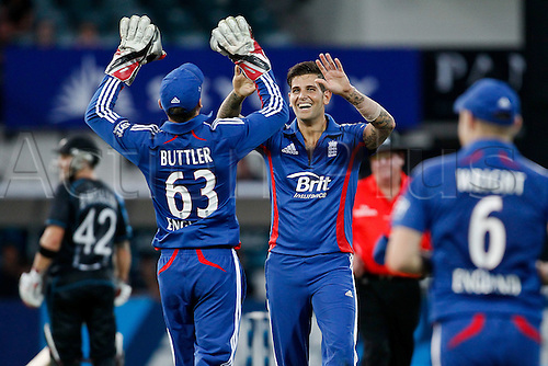 12.02.2013. Hamilton, New Zealand.  England's Jade Dernbach and England's Joss Buttler celebrate the wicket of Black Cap's Grant Elliot.  ANZ T20 series. 2nd Twenty20 Cricket international.  New Zealand Black Caps vs England at Seddon Park, Hamilton, New Zealand.