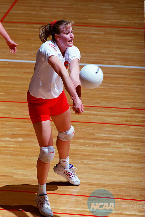 Caption: University of Washington's Amy Albers hits the ball during the NCAA Division III Women's Volleyball Championship December 3, 1994, in Ithaca, NY. Washington defeated the University of Wisconsin-Oshkosh. Tim McKinney/NCAA Photos.