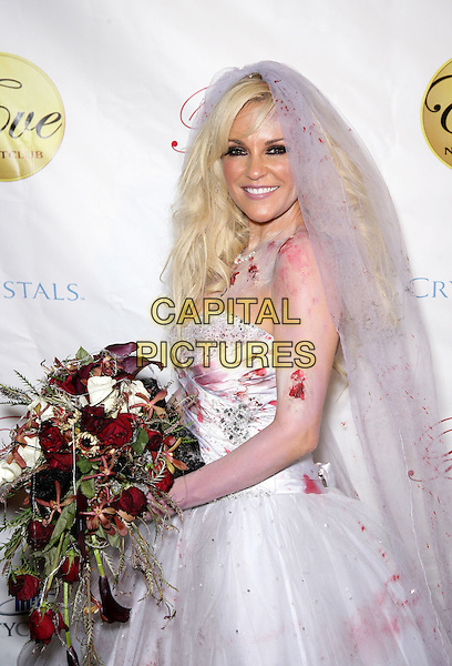 BRIDGET MARQUARDT.Bridget Marquardt Hosts Halfway to Halloween Costume Party at Eve Nightclub in Crystals at CityCenter, Las Vegas, Nevada, USA, 24th April 2010..half  length bride blood flowers veil white dress bouquet strapless make-up body paint wedding side .CAP/ADM/MJT.© MJT/AdMedia/Capital Pictures.
