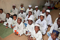 Zanzibar, Tanzania.  Young Boys in Madrassa (Koranic School).  Girls sit in back.