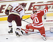 Jimmy Hayes (BC - 10), Corey Trivino (BU - 10) - The Boston College Eagles defeated the visiting Boston University Terriers 5-2 on Saturday, December 4, 2010, at Conte Forum in Chestnut Hill, Massachusetts.