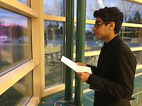 The Harker School - US - Upper School - Sophomore Azhar Huda practices his case at Apple Valley MN debate tournament - photo by Carol Green