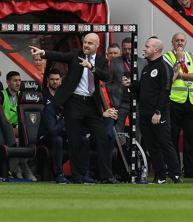 Burnley manager Sean Dyche (left) not happy and in discussion with the fourth official Simon Hooper after Burnley's Ashley Barnes was given a yellow card<br /> <br /> Photographer David Horton/CameraSport<br /> <br /> The Premier League - Bournemouth v Burnley - Saturday 6th April 2019 - Vitality Stadium - Bournemouth<br /> <br /> World Copyright © 2019 CameraSport. All rights reserved. 43 Linden Ave. Countesthorpe. Leicester. England. LE8 5PG - Tel: +44 (0) 116 277 4147 - admin@camerasport.com - www.camerasport.com