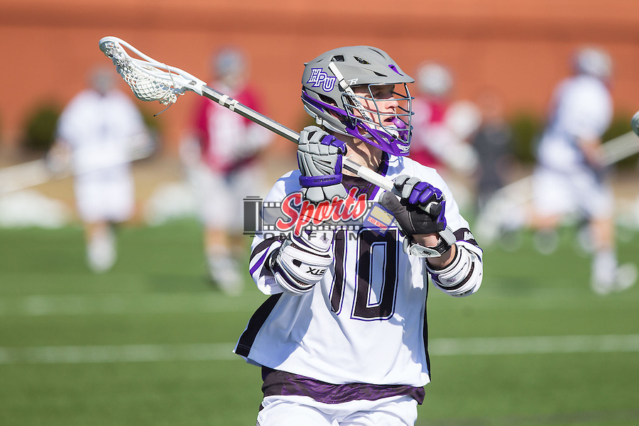 Brad James (10) of the High Point Panthers on the attack against the St. Joseph's Hawks at Vert Track, Soccer & Lacrosse Stadium on February 16, 2014 in High Point, North Carolina.  The Panthers defeated the Hawks 9-7.   (Brian Westerholt/Sports On Film)