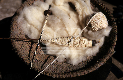 Koatinemo village, Brazil. Cotton thread with raw cotton and a spinning spindle in a basket.