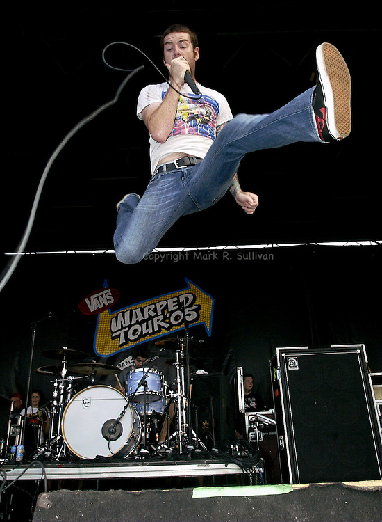 (METRO)--37431-ON SUN AUG 14,2005--WARPED0814B-- Buddy Nielsen of the Bergen County based Senses Fail leaps off the stage during their appearance on the main stage of the Van's Warped Tour as the annual day of concerts was held at Old Bridge Twp. Raceway Park in Old Bridge.(MARK R. SULLIVAN/HNT CHIEF PHOTOGRAPHER)