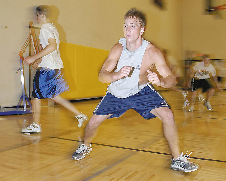 Sentinel/Dan Irving.Zeeland West High School senior Nick Otten runs through a conditioning exercise as part of Exel-R-ation training Wednesday morning at Zeeland West High School..(6/28/06)