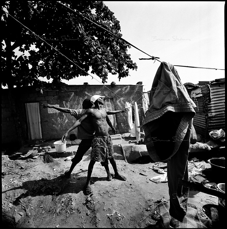 Luanda, Angola, May, 25, 2006.Porto do Pesqueiros, open air sewer; children playing in garbage and cholera infected waters. Between February and June 2006, more than 30000 people were infected with cholera in Angola's worse outbreak ever; more than 1300 died.