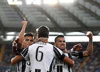 Calcio, Serie A: Lazio vs Juventus. Roma, stadio Olimpico, 27 agosto 2016.<br /> Juventus&rsquo; Sami Khedira, center, back to camera, celebrates with teammates, Paulo Dybala, left, and Dani Alves, after scoring the winning goal during the Serie A soccer match between Lazio and Juventus, at Rome's Olympic stadium, 27 August 2016. Juventus won 1-0.<br /> UPDATE IMAGES PRESS/Isabella Bonotto