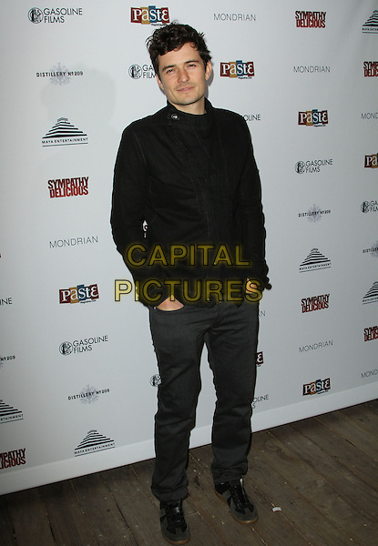 ORLANDO BLOOM .Special event for the release of Sympathy for Delicious Held At The Sky Bar, Mondrian Hotel, West Hollywood, California, USA, 27th April 2011..full length  black shirt trousers grey gray hands in pockets .CAP/ADM/KB.©Kevan Brooks/AdMedia/Capital Pictures.