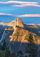 View of Half Dome and waterfals from Glacier Point with sunset clouds. Yosemite National Park, California. Sky has been added.