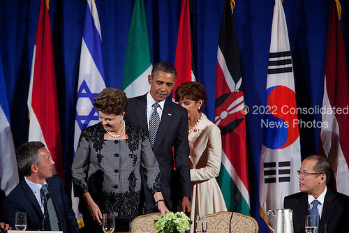 United States President Barack Obama, left, and President Dilma Rousseff of Brazil, second left, arrive for a meeting of the Open Government Partnership, a global effort to make governments better at the Waldorf-Astoria in New York, New York on Tuesday, September 20, 2011.  From left to right: Jens Stoltenberg, Prime Minister of Norway; President Dilma Rousseff of Brazil; President Barack Obama;  unknown; and President Benigno S. Aquino III of Philippines..Credit: Allan Tannenbaum / Pool via CNP