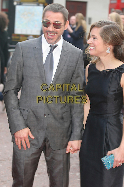 "ROBERT DOWNEY JR. & SUSAN LEVIN .Attending the ""Iron Man"" UK Film Premiere at the Odeon, Leicester Square, London, England, .24th April 2008..half length sunglasses grey gray tie beard black dress suit married husband wife .CAP/DS.©Dudley Smith/Capital Pictures"