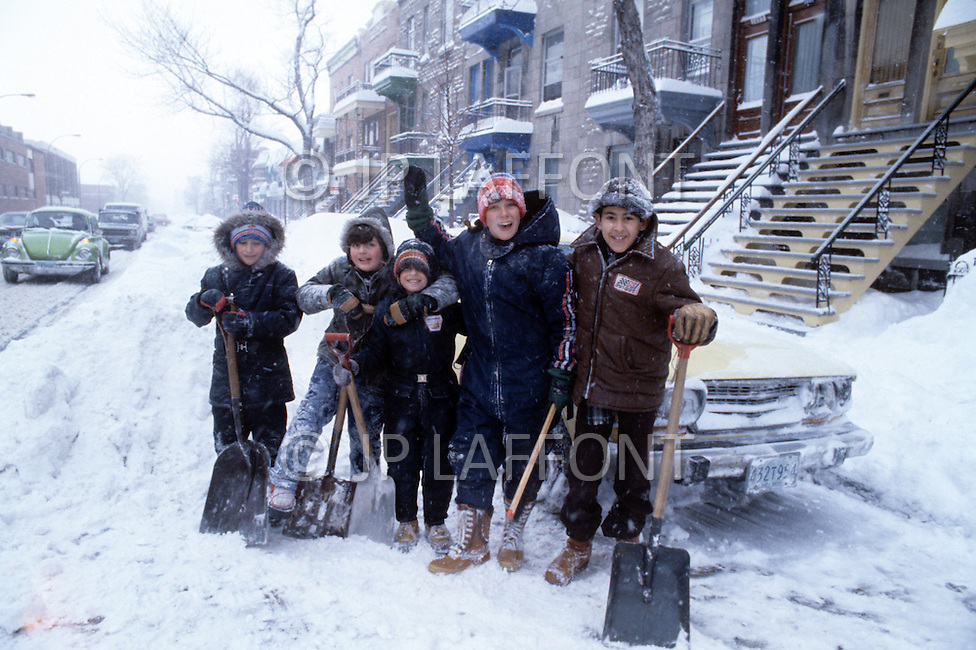 Montreal, Canada, March 1978. The streets in Winter. Citizens shoveling snow.