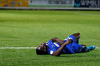 Michael Folivi of AFC Wimbledon lays prone during the The Leasing.com Trophy match between AFC Wimbledon and Leyton Orient at the Cherry Red Records Stadium, Kingston, England on 8 October 2019. Photo by Carlton Myrie / PRiME Media Images.