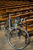 A bicycle stands against chairs during the annual blessing of the bicycles at the Cathedral of St John the Divine in New York City, USA, 22 April 2006. Several dozens cyclists, professional and recreational, and a few roller skaters attended the ceremony  during which prayers are said for those who died in cycling accidents this year and for a safe season.