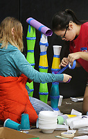 NWA Democrat-Gazette/DAVID GOTTSCHALK  Kayla Jones (left), a sixth grade student at Helen Tyson Middle School in Springdale, uses tape and plastic cups with Michaela Bowen, also a sixth grade student, Monday, April, 17, 2017, to build a ramp as they compete in the Junkyard Challenge during the Northwest Arkansas Science Olympian Tournament 2017 at Prairie Grove Christian Church in Prairie Grove. The two day tournament matches both elementary and middle school students from the area in events that include a Mystery Bridge, Balloon Joust and Marshmallow Catapult.