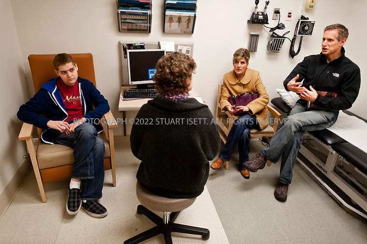 1/25/2012--Seattle, WA, USA..Patient Cody Broadbent, 19, from Poulsbo, WASH., (left) at University of Washington's Division of Pain Medicine in Seattle, WASH. Broadbent suffers from Crohn's disease and was at the UW to consult about managing his pain. Here he meets Rebecca Taylor, RN, Care Coordinator at the center (2nd left). Broadbents' parents, Scott and Kendra sit on the right...Washington State has developed new regulations meant to stop doctors from prescribing higher doses of powerful and often dangerous pain killers for patients who are not benefiting from them. Nationwide, fatalities from prescription drug overdoses are the second-leading cause of accidental death behind car accidents and, in some states, are the leading cause...©2012 Stuart Isett. All rights reserved.