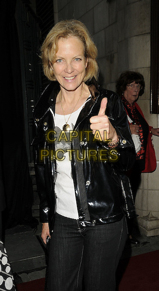 "JENNY SEAGROVE.The ""Dreamboats & Petticoats the Musical"" press night, Savoy Theatre, The Strand, London, England..July 27th, 2009.half length black leather jacket shiny hand thumb up .CAP/CAN.©Can Nguyen/Capital Pictures."