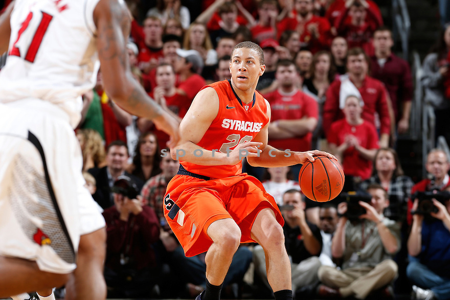 LOUISVILLE, KY - JANUARY 19: Brandon Triche #20 of the Syracuse Orange brings the ball up court against pressure from the Louisville Cardinals during the game at KFC Yum! Center on January 19, 2013 in Louisville, Kentucky. Syracuse defeated Louisville 70-68. Brandon Triche
