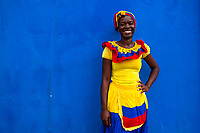 An Afro-Colombian girl, dressed in the traditional 'palenquera' costume, poses for a picture in walled city of Cartagena, Colombia, 12 December 2017. With the peace agreement, ending a 52-year civil conflict and promising political stability, together with rapid economic growth and unexploited tourism potential, Colombia has truly become a holiday destination. Cartagena, a UNESCO World Heritage site on the tropical Caribbean coast, plays the primary role in Colombia's tourism renaissance. The historic sites from the Spanish colonial times are being restored, private investments are visible throughout the city and an increased number of local people benefit from the boom of the travel related services.
