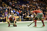 Berlin, Germany, January 31: During the 1. Bundesliga Herren Hallensaison 2014/15 semi-final hockey match between Rot-Weiss Koeln (dark blue) and Club an der Alster (red) on January 31, 2015 at the Final Four tournament at Max-Schmeling-Halle in Berlin, Germany. Final score 4-3 (2-2). (Photo by Dirk Markgraf / www.265-images.com) *** Local caption *** (r) Dieter Enrique Linnekogel #16 of Club an der Alster