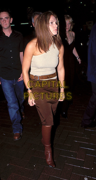 LOUISE ADAMS .(Victoria Beckham's sister).November 6th, 2000.belt, knee high boots, one shoulder top full length brown skirt.Ref: 10162.www.capitalpictures.com.sales@capitalpictures.com.© Capital Pictures