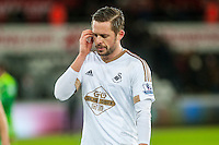 Gylfi Sigurdsson of Swansea looks dejected at final whistle  of the Barclays Premier League match between Swansea City and Sunderland played at the Liberty Stadium, Swansea  on  January the 13th 2016