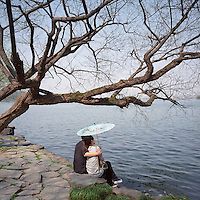 A couple shares a light moment at West Lake in Hangzhou, Zhejiang province, 2012. (Mamiya 6, 75mm, Kodak Ektar 100 film)