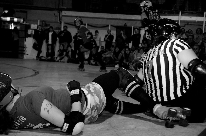"San Francisco ShEvil Dead skater ""Exquisite Corpse"" takes a fall as she tries to score on the Oakland Outlaws in the Bay Area Derby Girls season opener  on April 26th, 2008. The ShEvil Dead lost 66-103 against the Outlaws...(©Matt McKnight, 2008)"