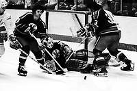 Kansas City Scouts Hugh Harvey, goalie Bill McKenzie and Dennis Patterson. (1975 action against the Seals)<br /> photo by Ron Riesterer)