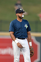 Third baseman Jose Brizuela (20) of the Columbia Fireflies plays defense in a game against the Charleston RiverDogs on Monday, August 27, 2018, at Spirit Communications Park in Columbia, South Carolina. Charleston won, 4-0. (Tom Priddy/Four Seam Images)