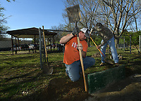 NWA Democrat-Gazette/ANDY SHUPE<br /> Paul Neal (center) from Wesley and Jerry Furgione (right) of Rogers, both members of the Northwest Arkansas Horseshoe Pitchers Association, use shovels Saturday, March 18, 2017, to reposition a backstop at one of several horseshoe pitching pits during a work day to prepare the group's Fayetteville facility ahead of a tournament planned for Saturday. The tournament begins at 10 a.m. at the complex in Walker Park. Spectators are encouraged to attend.