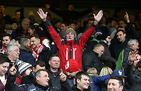 Swansea City fans celebrate after the final whistle of the Premier League match between Liverpool and Swansea City at Anfield, Liverpool, Merseyside, England, UK. Saturday 21 January 2017