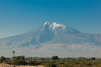 """Armenia. Ararat Province. Near the village of Araksavan.The tower marks the border with Turkey and a no man's land between both countries. View on the Ararat Mountain which is a snow-capped and dormant compound volcano in the extreme east of Turkey. It consists of two major volcanic cones: Greater Ararat and Little Ararat. Greater Ararat is the highest peak in Turkey and the Armenian Highland with an elevation of 5,137 m; Little Ararat's elevation is 3,896 m. The Ararat massif is about 35 km wide at ground base. The """"mountains of Ararat"""" have been widely accepted in Christianity as the resting place of Noah's Ark, despite contention that Genesis 8:4 does not refer specifically to Mt. Ararat. It is the principal national symbol of Armenia and has been considered a sacred mountain by Armenians. It is featured prominently in Armenian literature and art and is an icon for Armenian irredentism. 3.10.2019 © 2019 Didier Ruef"""