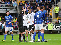 Referee Tony Harrington shows Swansea City's Ben Cabango the yellow card<br /> <br /> Photographer Ian Cook/CameraSport<br /> <br /> The EFL Sky Bet Championship - Cardiff City v Swansea City - Sunday 12th January 2020 - Cardiff City Stadium - Cardiff<br /> <br /> World Copyright © 2020 CameraSport. All rights reserved. 43 Linden Ave. Countesthorpe. Leicester. England. LE8 5PG - Tel: +44 (0) 116 277 4147 - admin@camerasport.com - www.camerasport.com
