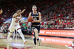 RALEIGH, NC - FEBRUARY 03: Notre Dame's Rex Pflueger (0) and NC State's Allerik Freeman (12). The North Carolina State Wolfpack hosted the University of Notre Dame Fighting Irish on February 3, 2018 at PNC Arena in Raleigh, NC in a Division I men's college basketball game. NC State won the game 76-58.