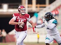 Hawgs Illustrated/BEN GOFF <br /> Cole Kelley, Arkansas quarterback, looks for a receiver under pressure from Marcus Williamson, Coastal Carolina defensive end, in the second quarter Saturday, Nov. 4, 2017, at Reynolds Razorback Stadium in Fayetteville.
