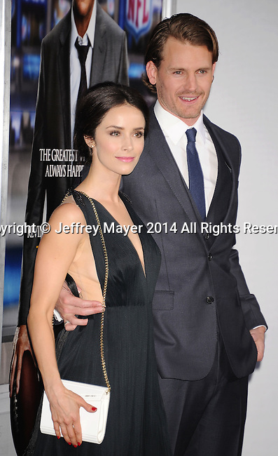 WESTWOOD, CA- APRIL 07: Actors Abigail Spencer (L) and Josh Pence attend the Los Angeles premiere of 'Draft Day' at the Regency Village Theatre on April 7, 2014 in Westwood, California.
