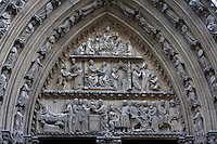 Portal of the rue du Cloître, depicting Jesus as a poor infant offered up to his father for the illumination of all nations, persecuted by King Herod and forced to flee, sculpted by Jean de Chelles, 1250, North façade, Notre Dame de Paris, 1163 ? 1345, initiated by the bishop Maurice de Sully, Ile de la Cité, Paris, France. Picture by Manuel Cohen